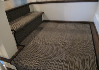 A carpet runner on a custom staircase by Floors Direct North