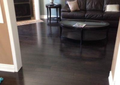 A dark hardwood floor, installed by Floors Direct North