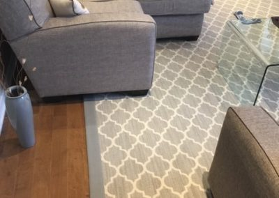 Hardwood floors and an area rug - Floors Direct North